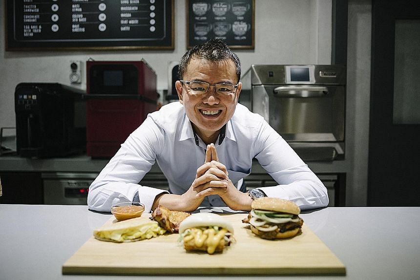 Mr Eric Er, vice-president of operations for No Signboard Holdings' new Hawker quick service restaurant, says the chain's burgers will feature flavours such as chilli crab, satay and chicken rice.