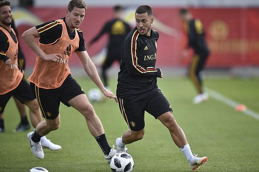Eden Hazard skips past the challenge of team-mate Jan Vertonghen during training. Both players, key to the Belgium side, may be rested in the match against England that will determine who tops the group.