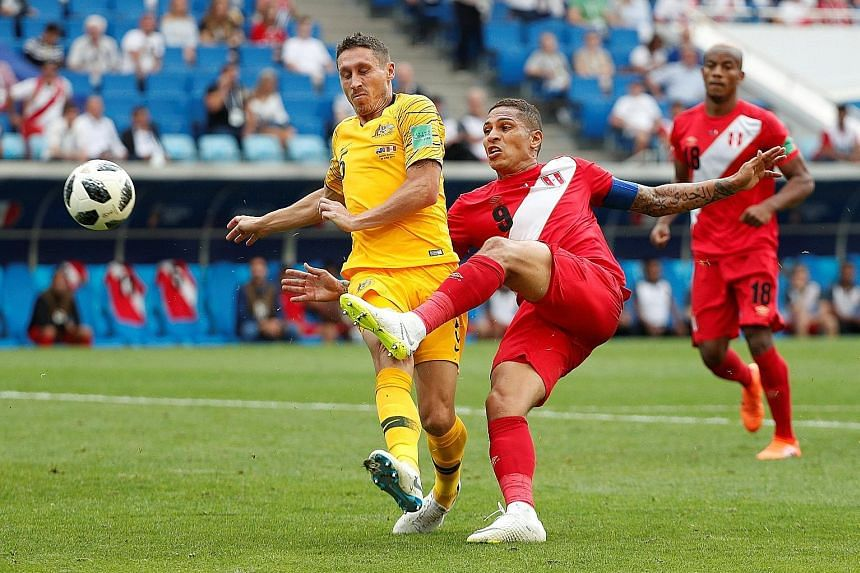 Left: Paolo Guerrero volleying in the second goal in Sochi to end Australian hopes. Peru's captain and all-time top scorer also made the opener for Andre Carrillo as the South Americans ended their campaign on a high. Below: Denmark's Christian Eriks
