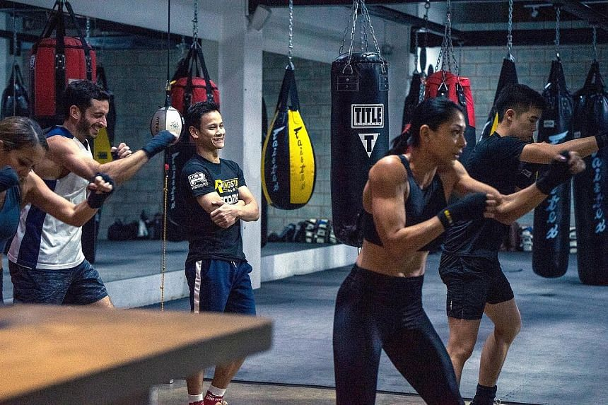 International Boxing Organisation intercontinental featherweight champion Muhamad Ridhwan watches as boxers run through their drills under his tutelage. Some 25 members of The Ring boxing community got tips from top local pros including Ridhwan and H