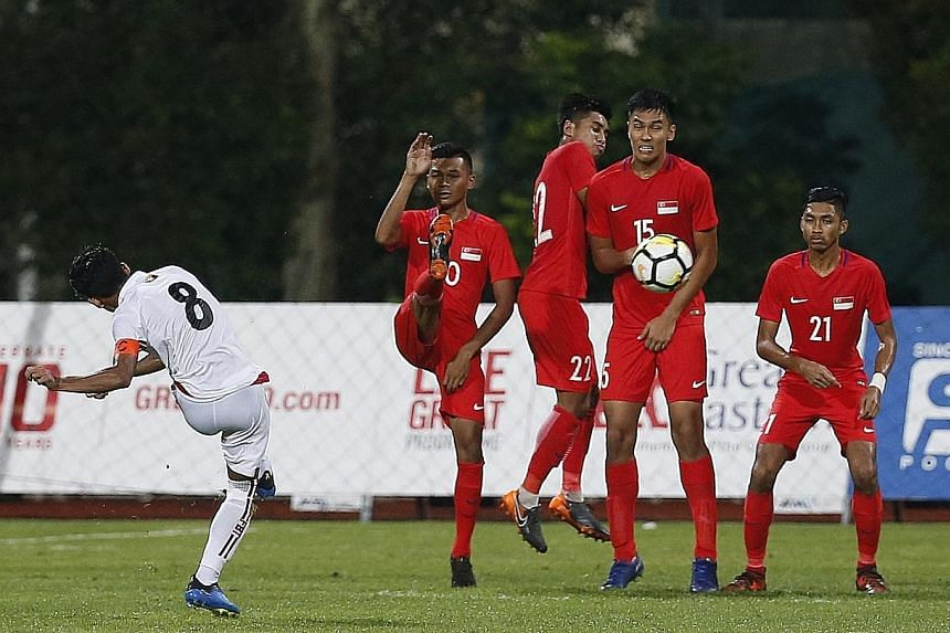The Singapore team defending a free kick in their Under-23 friendly loss to Myanmar at Bishan Stadium last week. Fandi Ahmad's team will not feature at August's Asian Games.