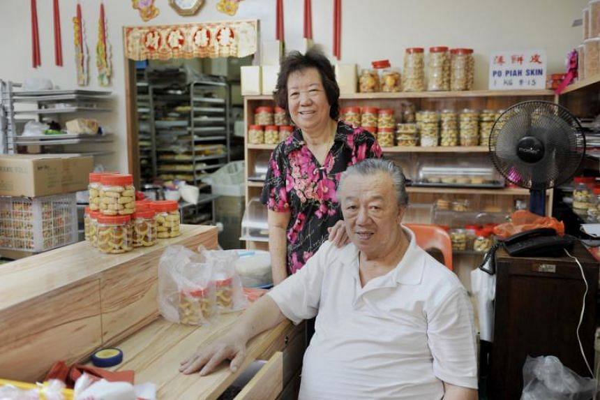 Mr Ng Sew Kuang (right) and his wife at their confectionery, Ng Kian Seng Confectionery. Mr Ng died in a workplace accident while operating an industrial gas-heated cooking mixer on June 25, 2018.