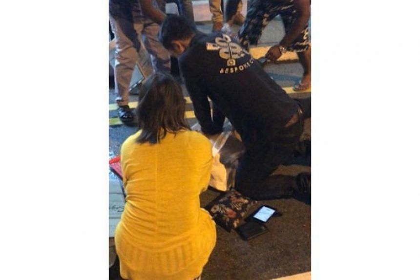 Mr Muhammad Faizal Ibrahim, 26, and his girlfriend Noor Hafawati Othman, 28, rushed to the man's side when they saw that he had collapsed.