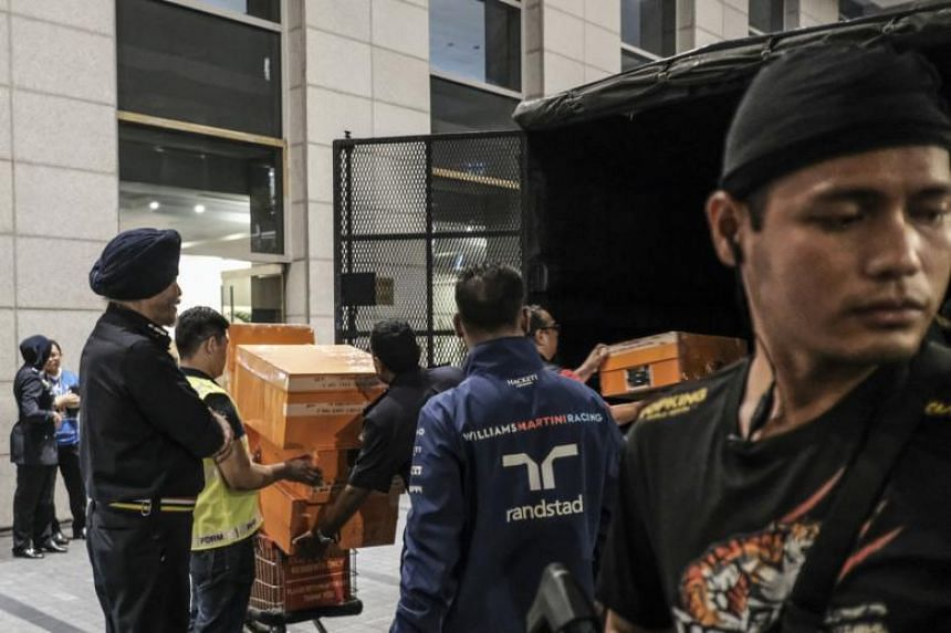 Several boxes of items being loaded into a Royal Malaysia Police truck by officers during a raid at an apartment unit owned by former Malaysian prime minister Datuk Seri Najib Tun Razak at the Pavilion Residences, in Kuala Lumpur, Malaysia, on May 18