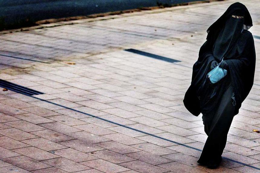 A woman wearing a burqa walks in The Hague on Dec 1, 2014.