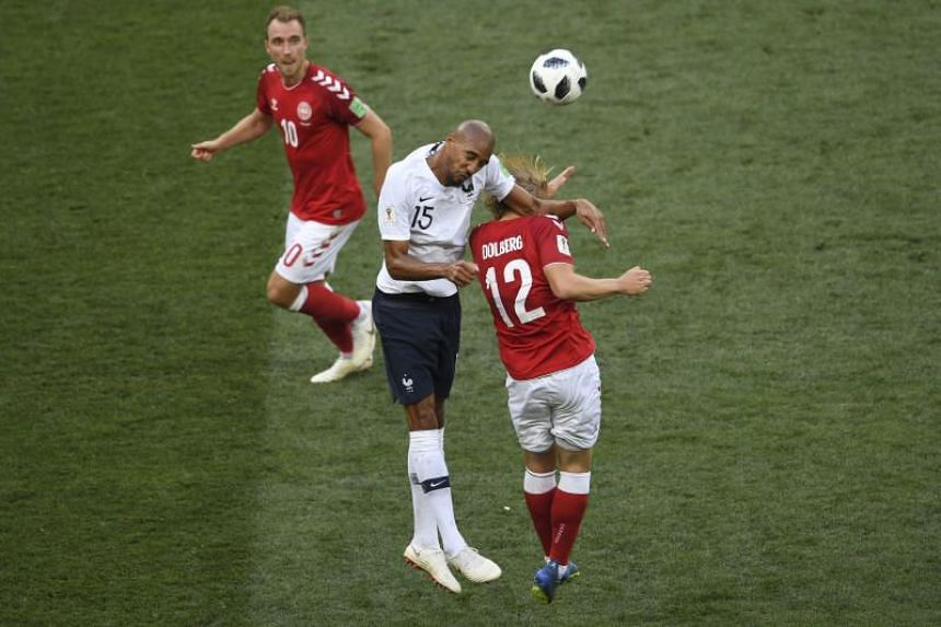 Denmark's forward Kasper Dolberg (right) vies for the header with France's midfielder Steven N'Zonzi (centre) during the Russia 2018 World Cup Group C football match between Denmark and France at the Luzhniki Stadium in Moscow on June 26, 2018.