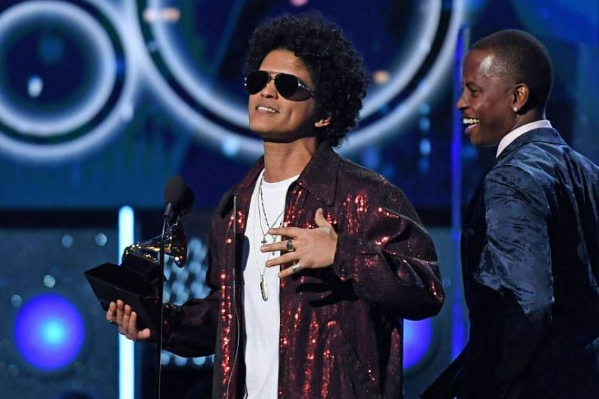 Bruno Mars receives a second Grammy for Record of the Year during the 60th Annual Grammy Awards show in New York, on Jan 28, 2018.
