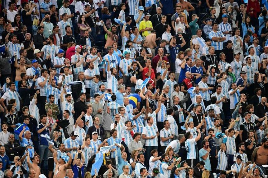 Argentina supporters cheer at the end of the Russia 2018 World Cup Group D football match between Nigeria and Argentina at the Saint Petersburg Stadium in Saint Petersburg, on June 26, 2018.