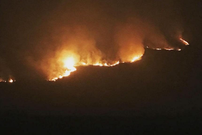 An area six kilometres long had been affected and 34 homes have been evacuated in the village of Carrbrook to the west of the blaze.