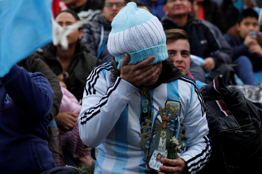 An Argentina fan reacts as he watches a broadcast of the World Cup Group D match between Argentina and Nigeria, in Buenos Aires.