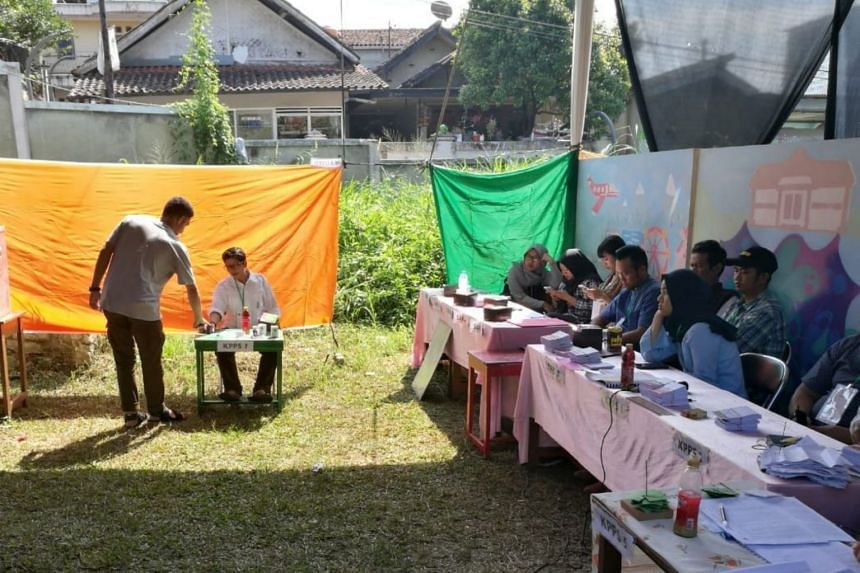 Officials at a polling station in the Babakan Ciamis area in Bandung, Indonesia, on June 27, 2018.