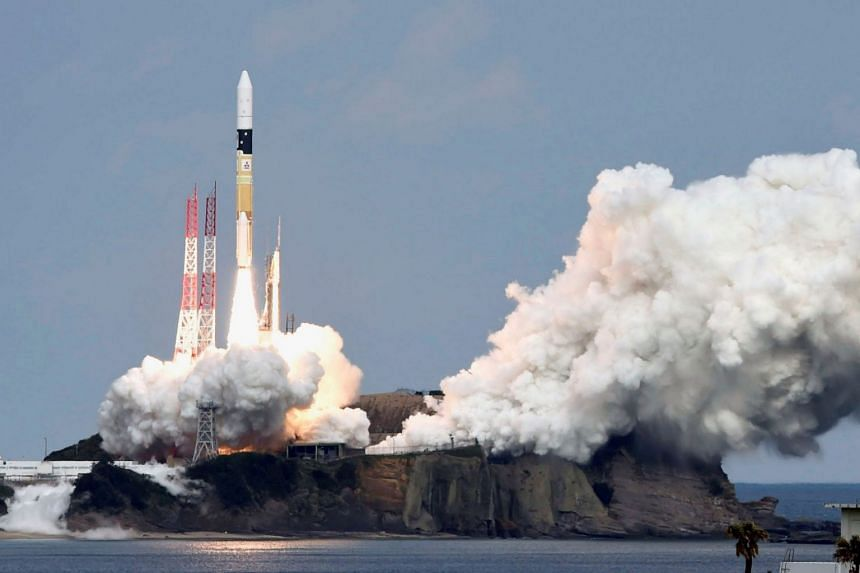 File photo showing a rocket carrying the Hayabusa 2 space probe blasting off from a launch pad at the Tanegashima Space Center, on December 3, 2014.
