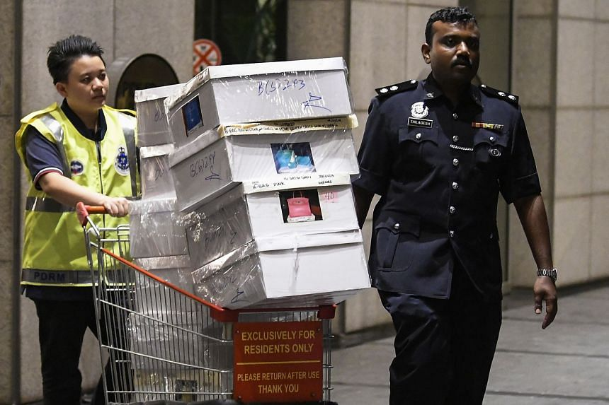 Boxes of items seized by the Royal Malaysian Police at the Pavilion Residences in Kuala Lumpur, Malaysia, on May 18, 2018.