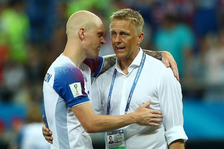 Iceland coach Heimir Hallgrimsson (right) with Emil Hallfredsson at the end of the World Cup 2018 group D football match against Croatia on June 26, 2018.