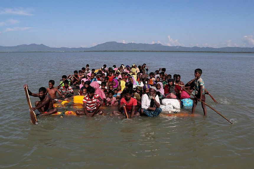 Rohingya refugees fleeing to Bangladesh on an improvised raft, on Nov 10, 2017. Myanmar's leaders are under fire for taking little punitive action against its military.