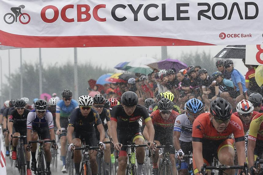 Cyclists getting in on the action during the Men's Open category of 2017's OCBC Cycle National Road Championship at Seletar North Link, on May, 21 2017..