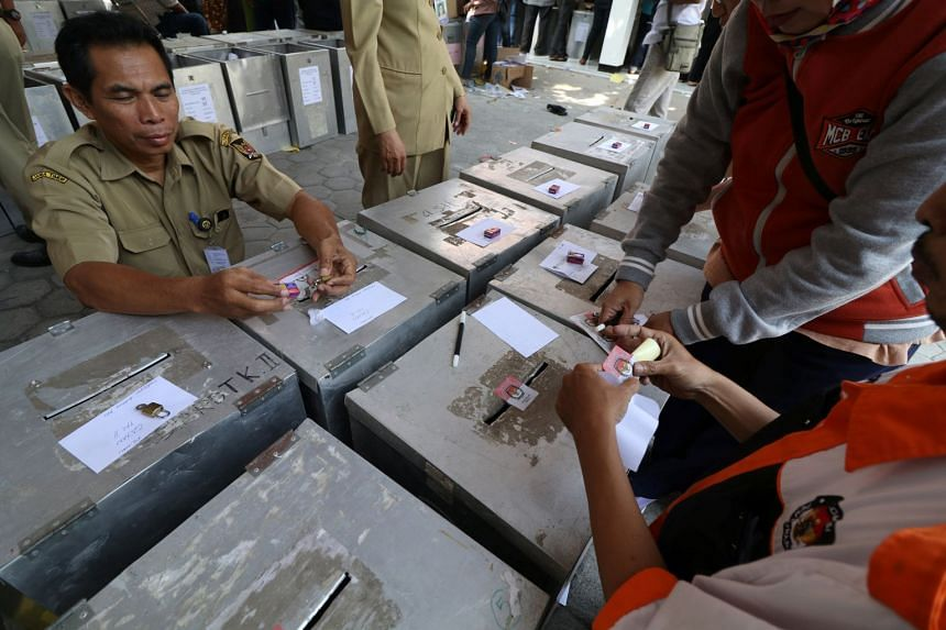 Government employees and election officials prepare ballot boxes ahead of regional elections in Kediri, East Java, Indonesia, on June 25, 2018.