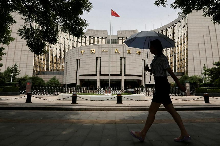File photo showing The People's Bank of China's (PBOC) headquarters in Beijing. The PBOC sets the midpoint rate every morning for the Chinese currency is not freely traded yet.