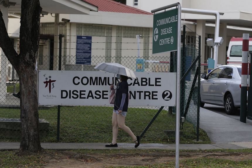 A lady walking past Tan Tock Seng Hospital's Communicable Disease Centre, where  a patient repeatedly absconded from while being treated for tuberculosis.