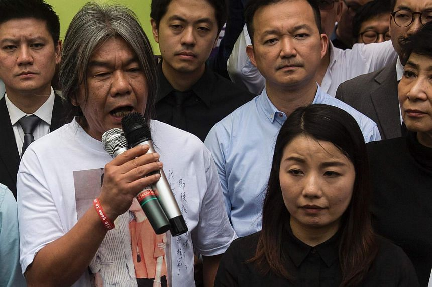 Ousted democratic lawmaker Lau Siu-lai (right) and former lawmaker Leung Kwok-hung speak to the media in Hong Kong, on July 14, 2017.