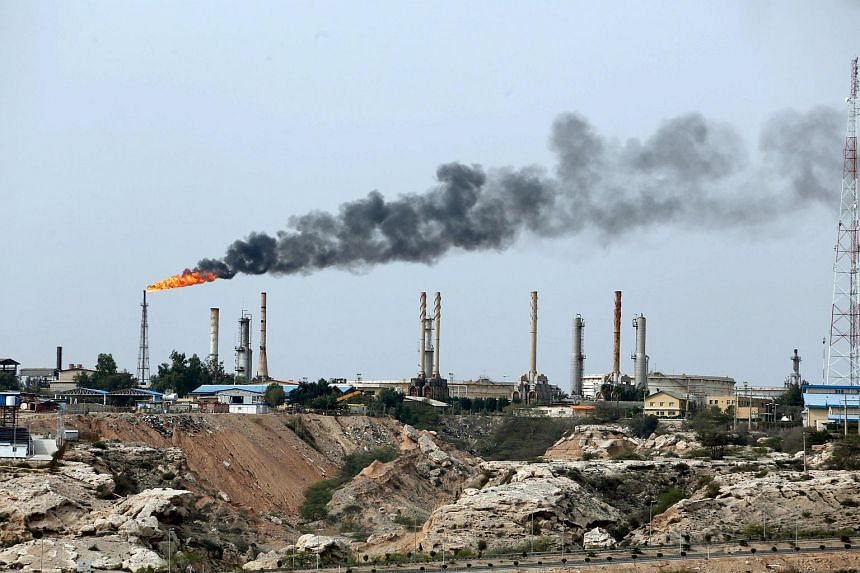 A file photo showing an oil facility in the Khark Island on the shore of the Gulf. Oil prices rose when the US said they will impose sanctions against all importers of Iranian oil, on June 26, 2018.