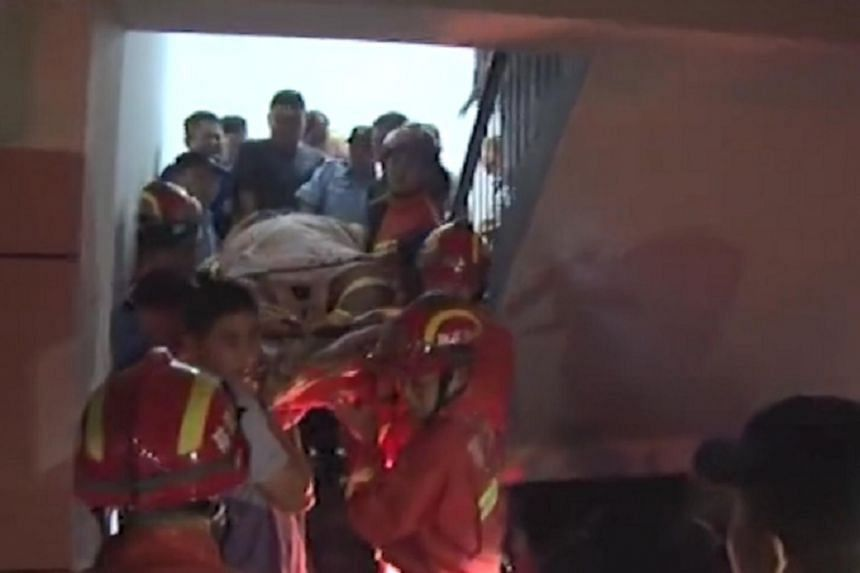 Firefighters and volunteers from Blue Sky Rescue helped carry Mr Zhu's 31-year-old son down three flights of stairs to an ambulance, a process that took more than three hours.