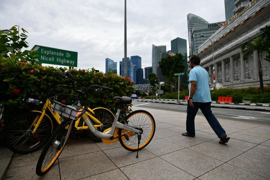 An ofo bike and oBike bicycle parked opposite The Fullerton Hotel, on June 27, 2018.