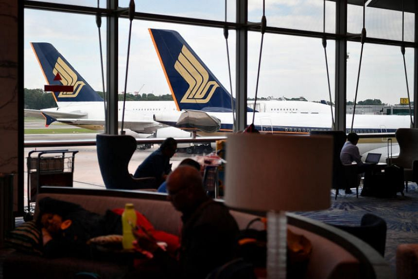 Singapore Airlines planes at Changi Airport Terminal 3. Two flights, one bound for Bangkok and another for Melbourne, were stranded at Changi Airport for up to about six hours on June 27 because of aircraft problems.