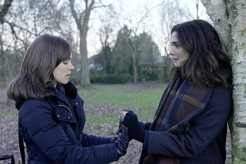 Rachel McAdams (left) and Rachel Weisz are in a triangular love story in Disobedience.