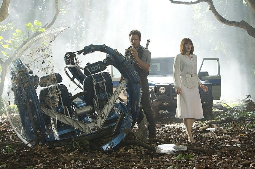 Bryce Dallas Howard (above, with Chris Pratt) runs in high-heeled shoes from dinosaurs in Jurassic World.