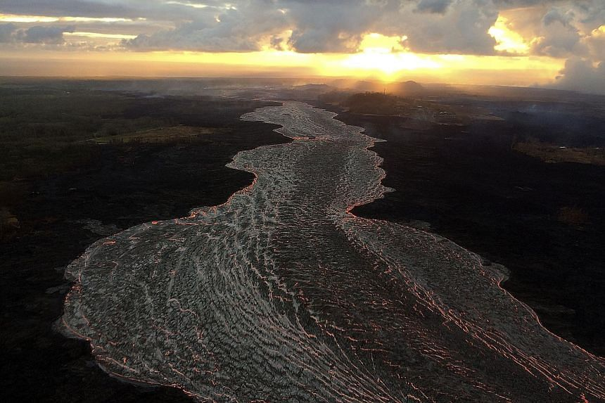 An early-morning view of an open lava channel at Kilauea volcano in Hawaii, seen during a helicopter overflight of the Lower East Rift Zone on Monday, in an image obtained on Tuesday from the United States Geological Survey (USGS). The latest video f