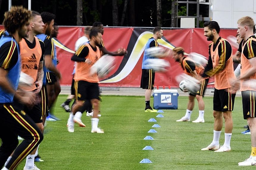 Belgium's players take part in a drill at their training base at the Moscow Country Club ahead of their match against England. Both teams have qualified, and will play in Kaliningrad to decide the group winners.