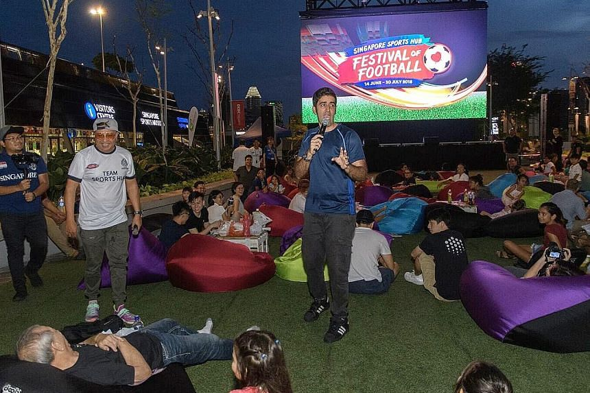 Comedian Rishi Budhrani entertaining football fans waiting for the live screening of a World Cup match at the Singapore Sports Hub.