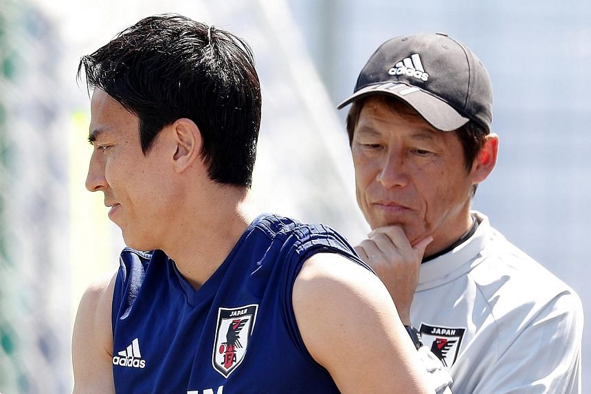 Japan head coach Akira Nishino, seen here with captain Makoto Hasebe during training, expects a tough match against Poland, knowing that the Poles do not want to go home losing all their three matches.
