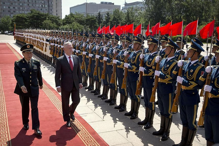 """US Defence Secretary James Mattis reviewing an honour guard with China's Defence Minister Wei Fenghe during a welcome ceremony in Beijing yesterday. Describing Mr Mattis' visit as a """"positive factor"""", General Wei made clear Beijing's position and con"""