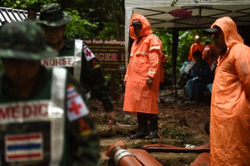Thai military paramedics are seen in Khun Nam Nang Non Forest Park near Than Luang cave in Chiang Rai province during rescue operation for a missing children's football team and their coach on June 28, 2018.