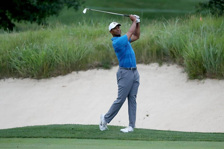 Tiger Woods follows his second shot into the first hole in the Pro-Am prior to the Quicken Loans National at TPC Potomac in Maryland on June 27, 2018.
