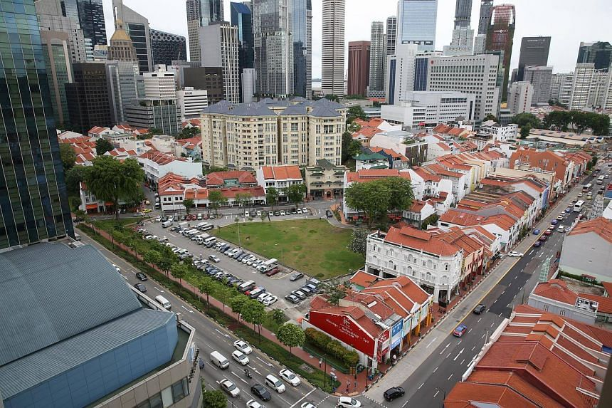 The land parcel (patch of green and carpark) at Cross Street and Club Street.