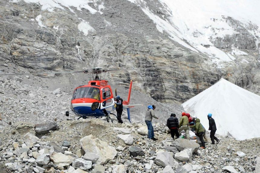 File photo showing a helicopter delivering supplies to Everest base camp, some 140 kilometres northeast of Kathmandu, on April 24, 2018.