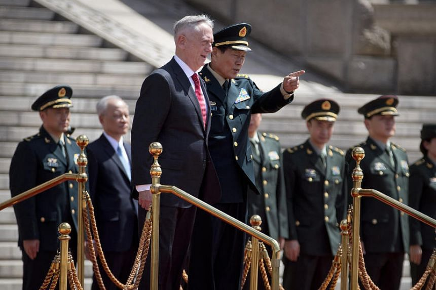 US Defense Secretary Jim Mattis and China's Defense Minister Wei Fenghe at a welcome ceremony at the Bayi Building in Beijing on June 27, 2018.