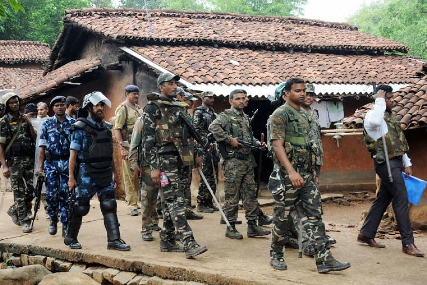 Indian security forces patrolling around Ghagra village in Khunti district in India's eastern Jharkhand state, following the kidnapping of three policemen.