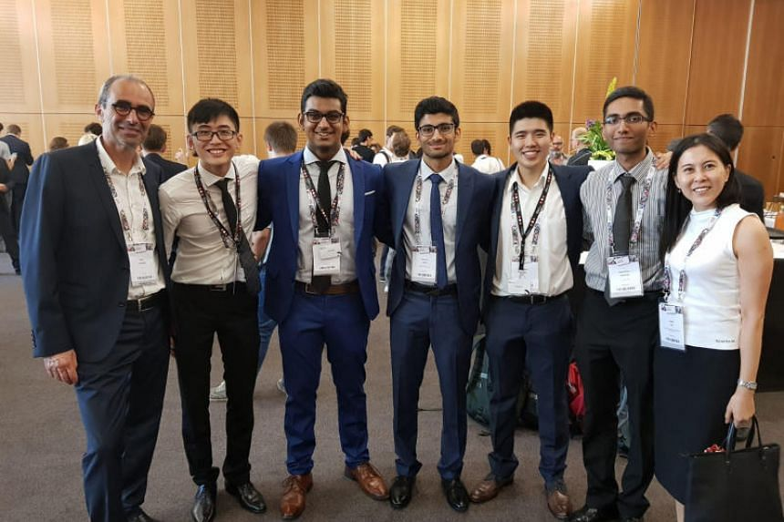 (From left)  Technology transfer officer in the Centre National d'Etudes Spatiales Didier Lapierre with members of team Insert Space Francis Lee,  Prince Soni, Rachiket Arya, Wilbert Tan, Vairavan Ramanathan and  Executive Director, Singapore Space