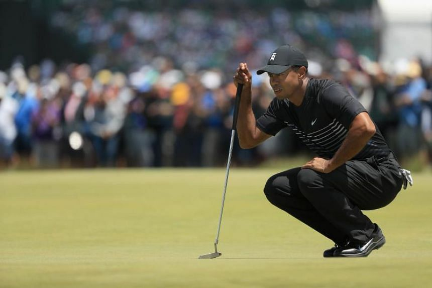 Tiger Woods lines up a put on the eighth green during the second round of the 2018 US Open at Shinnecock Hills Golf Club, on June 15, 2018.