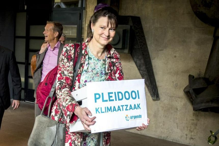 Marjan Minnesma, director of environmental group Urgenda, arrives at the court in The Hague on May 28, 2018, prior to the appeal from the Dutch government who ordered that in five years, greenhouse gas emissions must be reduced by 25 per cent compare