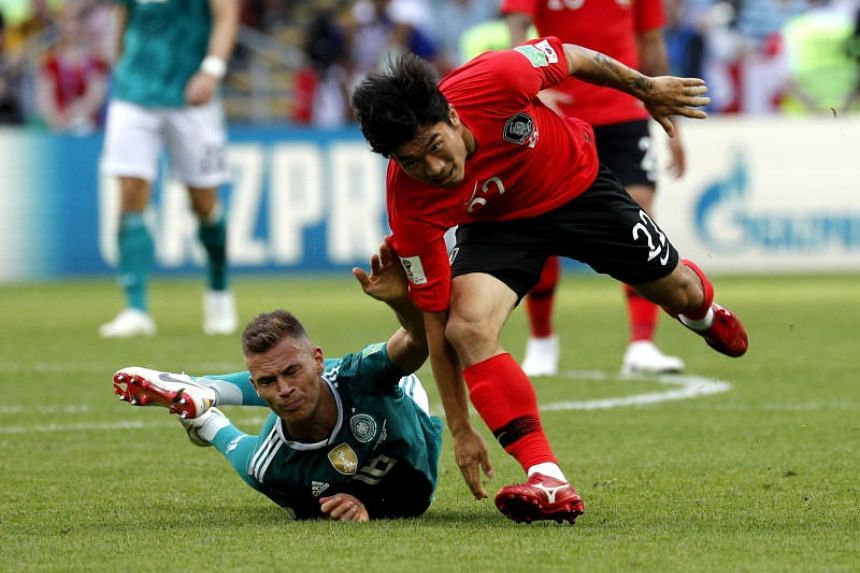 Joshua Kimmich of Germany (left) and Go Yo-han of South Korea in action during the Fifa World Cup 2018 group F preliminary round soccer match between South Korea and Germany in Kazan, Russia, on June 27, 2018.