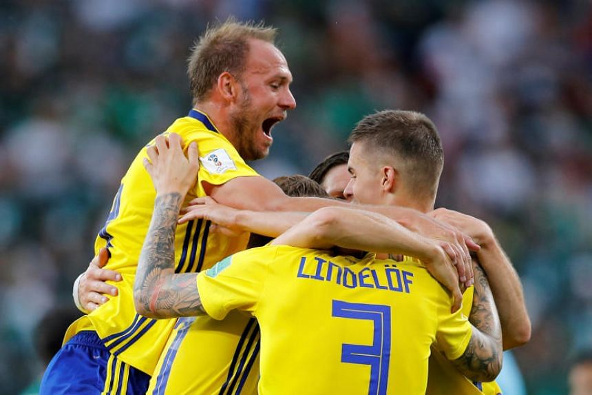 The Swedes, led by skipper Andreas Granqvist (left), staged a remarkable smash-and-grab raid that would have done their Viking ancestors proud, battering away at Mexico's suspect set-piece defence and just refusing to let their opponents to settle