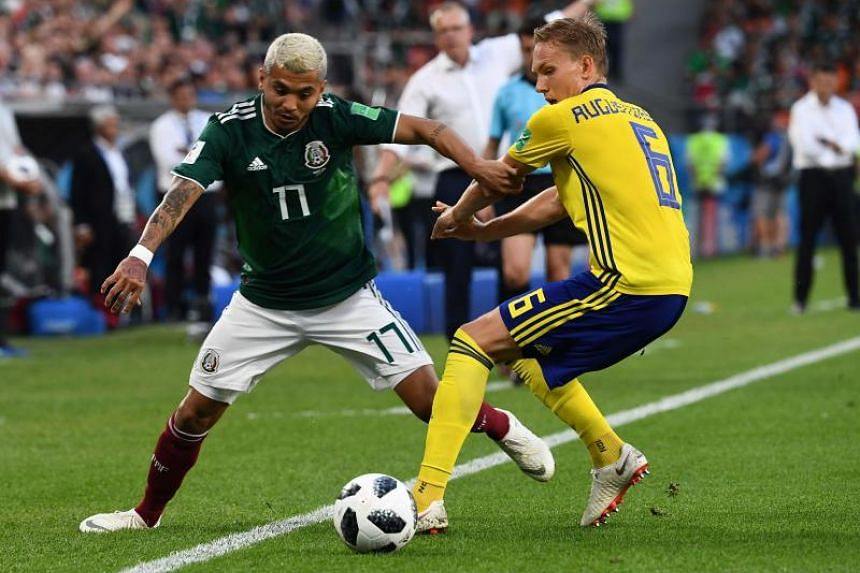 Mexico's forward Jesus Corona (left) and Sweden's defender Ludwig Augustinsson vie for the ball during the Russia 2018 World Cup Group F football match between Mexico and Sweden at the Ekaterinburg Arena in Ekaterinburg, on June 27, 2018.