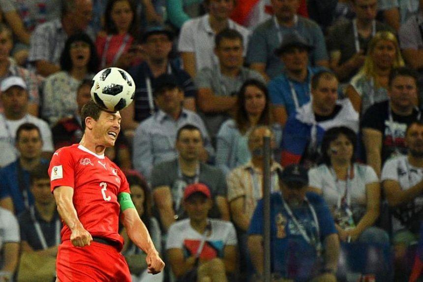 Switzerland's defender Stephan Lichtsteiner heads the ball during the Russia 2018 World Cup Group E football match between Switzerland and Costa Rica at the Nizhny Novgorod Stadium in Nizhny Novgorod on June 27, 2018.