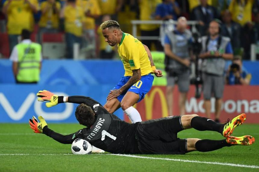 Serbia's goalkeeper Vladimir Stojkovic (left) attempts to save a shot by Brazil's forward Neymar during the Russia 2018 World Cup Group E football match between Serbia and Brazil at the Spartak Stadium in Moscow, on June 27, 2018.