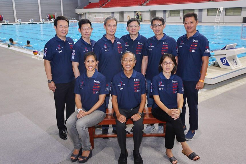 None of Mr Lee Kok Choy's (seated, centre) slate of 10 members faced any challengers during the elections at the OCBC Aquatic Centre's gymnasium, although there were a number of new faces in his team.